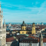 "Stunning aerial view at famous Munich tourist sights. So called ""Frauenkirche"", ""Marienplatz"" and ""Odeonsplatz"" in frame."